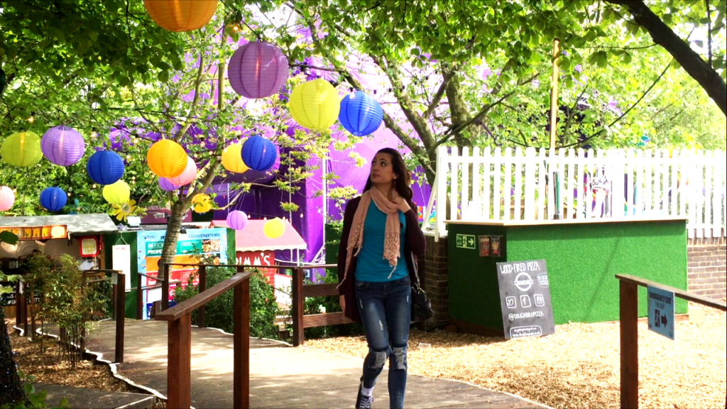 sabrina walking in a park i london with colored baloons